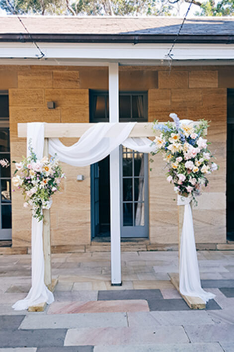Light Timber Wedding Arch With Drapery