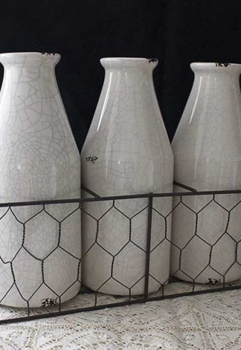 Sydney Event prop hire ceramic milk bottles with wire caddy